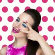 Bright pop art photo portrait of woman who looks on colored backgrounds — Stock Photo #69839023