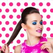 Bright pop art photo portrait of woman who looks on colored backgrounds — Stock Photo #70006163