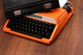 The Orange Vintage Typewriter on the Wood — Stock Photo