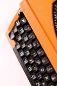 The Orange Vintage Typewriter on the White Background — Stock Photo