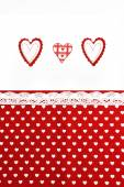 Valentines Day background with hand made hearts and fabric background — Stock Photo