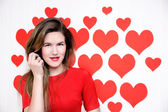 White caucasian woman with red lips standing on a heart shaped background.Valentines day — Stock Photo