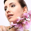 Beautiful Girl With Orchid Flowers. — Stock Photo #58748067