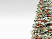 Christmas tree with colorful ornaments, isolated on white — Stock Photo