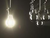 Illuminated fluorescent light bulbs — Stockfoto