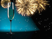 Champagne glasses with fireworks on background — Stock Photo