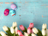 Hand-painted easter eggs with tulips — Stock Photo