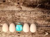 Easter eggs on wooden table background — Stock Photo