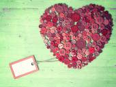 Red heart background on vintage old surface. — Stock Photo