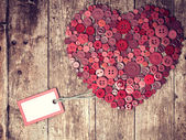 Red heart background on vintage old surface. — Fotografia Stock