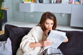 Young Happy Woman Reading Newspaper — Стоковое фото