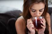 Portrait of young woman drinking tea — Stock Photo