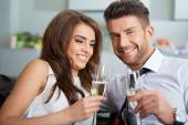Young couple with champagne glasses — Stock Photo
