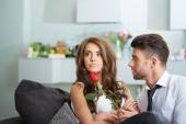 Portrait of two young people holding a rose — Stock Photo
