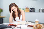 Young student woman with lots of books studying — Stock Photo