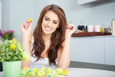 Smiling female laughing with colorful easter eggs — Stock Photo
