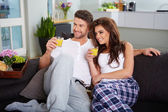 Young couple on the sofa — Stock Photo