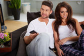 Couple relaxing on a sofa — Stock Photo
