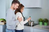 Romantic young couple preparing dinner. — 图库照片