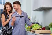 Romantic young couple preparing dinner. — Stock Photo