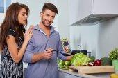 Romantic young couple preparing dinner. — Stock Photo