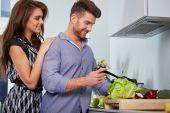 Romantic young couple preparing dinner. — Foto de Stock