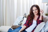 Relaxing woman sitting comfortable in sofa lounge chair — Stock Photo