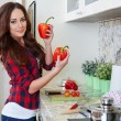 Постер, плакат: Young Woman Cooking Healthy Food