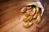 Baked potato with rosemary — Stock Photo