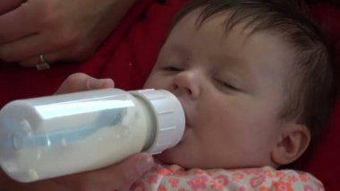 Baby drinks a milk from bottle — Stock Video