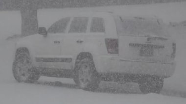 Snowing on a White Jeep Car — Stock Video