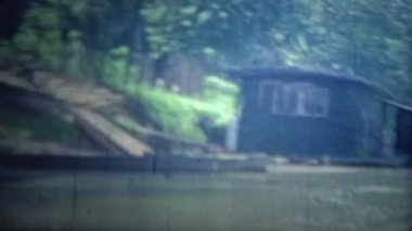Floating boathouses and living units on the flooded river. — Stock Video