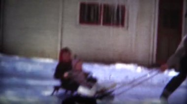 Dad pulling kids around in the sled — Stock Video