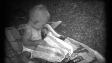 Baby playing around outside on a blanket — Stock Video