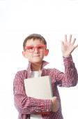 Portrait of a young happy boy in red spectacles . — Stock Photo