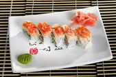 Sushi menu: a set of rolls of scallops with wasabi and ginger on a plate — Stock Photo