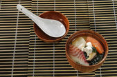 Sushi menu sushi with fish soup and cheese in a small platter — Stockfoto