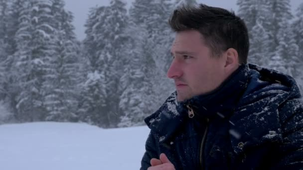 Man rubbing his hands and coughing in winter — Vídeo de stock