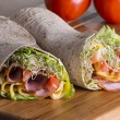 Wrapped tortilla sandwich rolls — Stock Photo #61242293