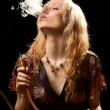 Woman smoking hookah. — Stock Photo #58382655