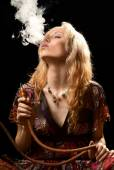 Woman smoking hookah. — Foto de Stock