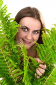 Woman with fern. — Stock Photo