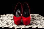 Shoes and money — Stock Photo