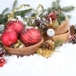 Christmas border with red bauble, golden present and snow — Stock Photo #58873655