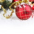 Christmas border with red bauble, golden present and snow — Stock Photo #58873659