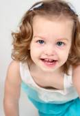 Cute little girl in  smiling — Stock Photo