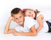 Boy and little girl smiling — Stock Photo