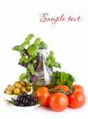 Fresh vegetables with olive oil — Stock Photo