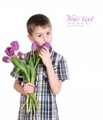 Smiling boy stretches forward bouquet of pink tulips — Stock Photo