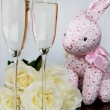 Champagne Glasses, Box of Chocolate, Bunch of White Roses and Pink Hare — Photo #63905775